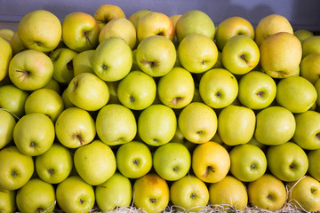Picture of fresh apples on counter in  food market, nobody
