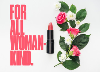 top view of flower composition, pink lipstick and for all woman kind lettering on white background