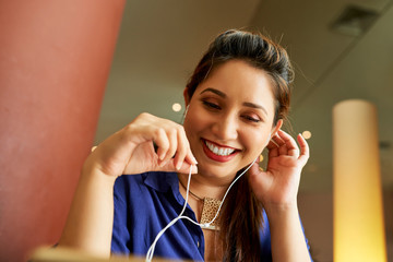 Businesswoman in earphones making call