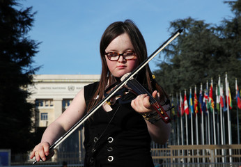Violinist Luethy performs during a flashmob event on World Down Syndrome Day in front of the United Nations in Geneva