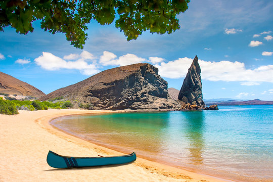 Galapagos Islands. Ecuador. Bartolome Island. Pinnacle Rock. Rocks in the water next to the sandy beach. Blue lagoon. Landscapes of the Galapagos.