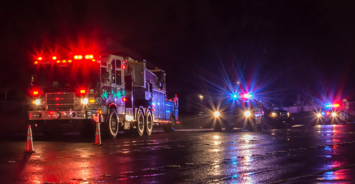 First Responders - firefighters and police officers - on a wet night