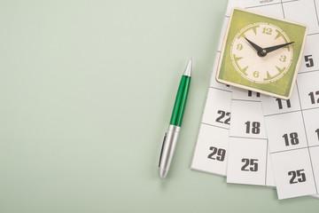 Calendar with dates, clock and pen