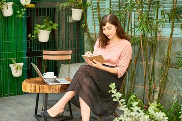 Creative woman working in backyard