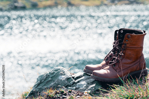 Close Up New Brown Leather Shoe On Mountain Lake View Point