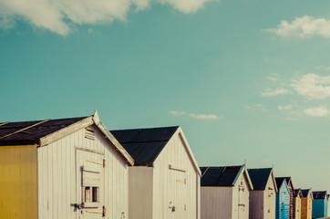 row of beach hut houses in Felixstowe, UK