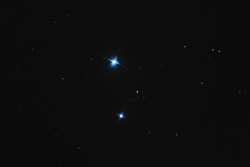 Close up to Mizar A and B double star and Alcor, in the Ursa Major constellation, taken by large newtonian telescope in the deep space.