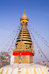 Swayambhunath or Monkey temple is an ancient religious architecture atop a hill in the Kathmandu Valley with a clear blue sky from Swayambhu, west of Kathmandu City, Nepal , March 2019