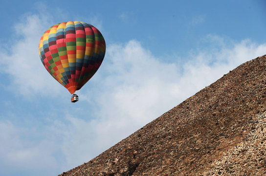 A hot air balloon floats over the Pyramid of the Sun during the spring equinox in the pre-hispanic city of Teotihuacan on the outskirts of Mexico City
