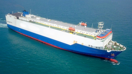 Aerial image of a Large RoRo (Roll on/off) Vehicle carrier vessel cruising the Mediterranean sea