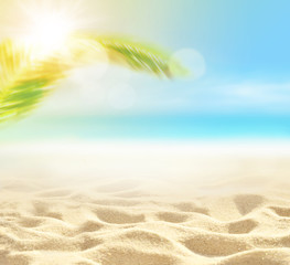 Sand with Palm and tropical beach bokeh background, Summer vacation and travel concept. Copy space