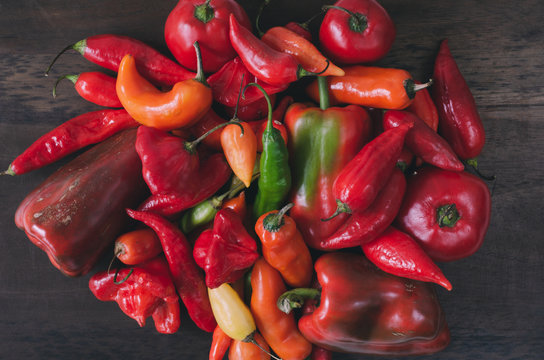 Peppers of various colors and shapes. Top view.