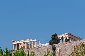 Athens, Parthenon ancient Greek temple, view from the street under the hill, plenty of space for text