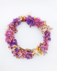 first of May handmade colorful flowers wreath, soft and airy on white background
