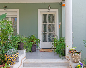 Athens Greece, contemporary house entrance with flower pots