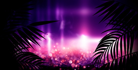 Fotomurales - Dark background with colorful bokeh of tropical leaves. Night view, gradient and abstract bokeh light. Magic twinkling sparkles.