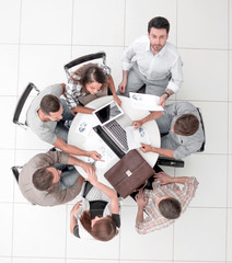 top view.employees work with financial documents