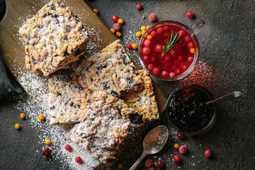 Delicious homemade cake with berry jam for tea on a dark background. Wall mural
