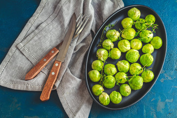 Brussels sprouts in served on black plate