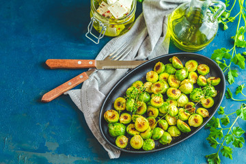 Black plate with delicious roasted Brussels sprouts