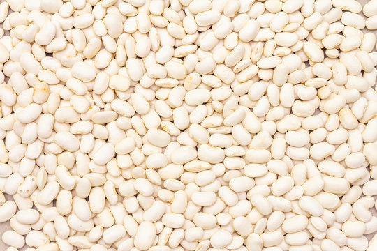 Dry lima beans stone background, top view, wallpaper, close up.