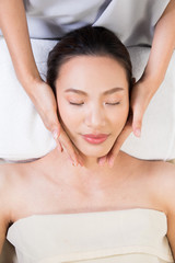 Fototapeta Ayurvedic Head Massage Therapy on facial forehead Master Chakra Point of Asian woman, Therapist Spa body woman hands treatment on customer to increase circulation release tension stress of think work
