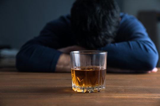sad man hand alcohol glass