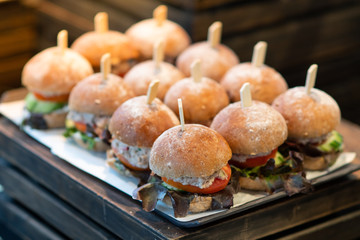 The appetizing burger is placed in a light buffet.