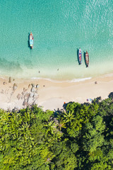 Wall Mural - View from above, aerial view of a beautiful tropical beach with white sand and turquoise clear water, long tail boats and people sunbathing, Banana beach, Phuket, Thailand.