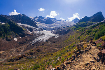 Huge mountain glacier in the surroundings of Dombai. Caucasus Mountains summer, clear day.