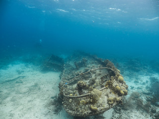 """Ship wreck """"Tugboat Saba"""" in coral reef of Caribbean sea around Curacao"""