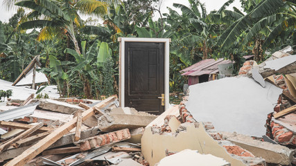 Standing Door of destroyed House after Earthquake disaster in Lombok, Indonesia – Meaningful Picture – Image.