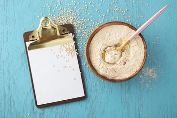 Quinoa flour in bowl with clipboard