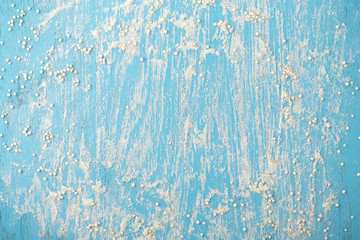 Quinoa flour with quinoa seeds on blue wooden background