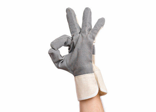 Worker showing gesture - ok sign. Male hand wearing working glove, isolated on white background.