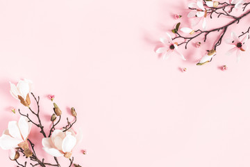 Flowers composition. Magnolia flowers on pastel pink background. Flat lay, top view, copy space