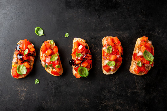 Classic italian bruschetta served on dark board