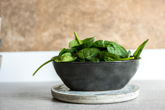 Fresh spinach on a modern crockery bowl on the kitchen