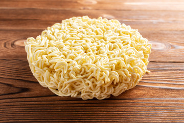 instant noodles or dried noodles on  wood table