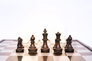 Picture of chess pawns on the chess board. Isolated on the white background.