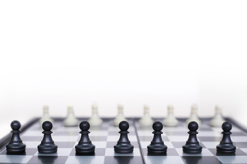 Chess pieces on a game board . Isolated on the white background.