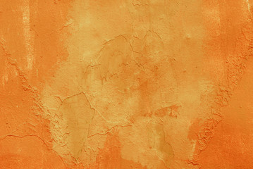 Metal surface carelessly painted in orange color, background