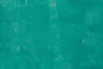 Metal surface carelessly painted in green color, background