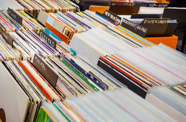 Browsing through old vinyl records in music shop. Music background.