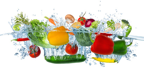 fresh vegetables splashing into blue clear water splash healthy food diet freshness concept...