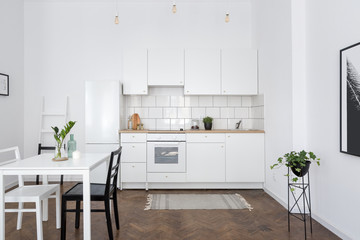 White kitchen interior with table