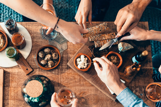 high angle view of hands picking up food from a table: togetherness, friendship, appetizer, aperitif, tapas moment concept