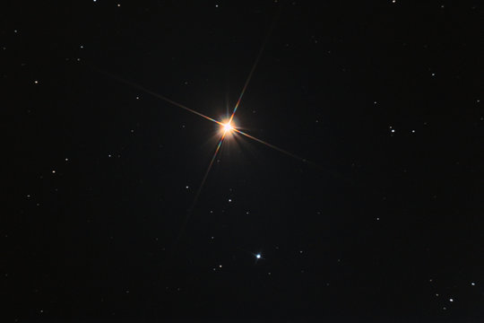 The Arcturus star in Boote constellation, called also apha Boo, taken with large diameter telescope in the dark space.
