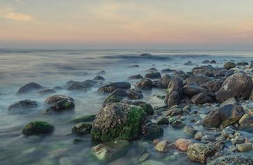 Nerja, Malaga, Andalusi, Spain - February 10, 2019: Playa del Molino, small stone beach with greenish rocks on the shore, Nerja, southern Spain
