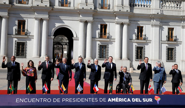 Presidents and delegates pose for a family photo during the Prosur summit, at the presidential palace La Moneda, in Santiago